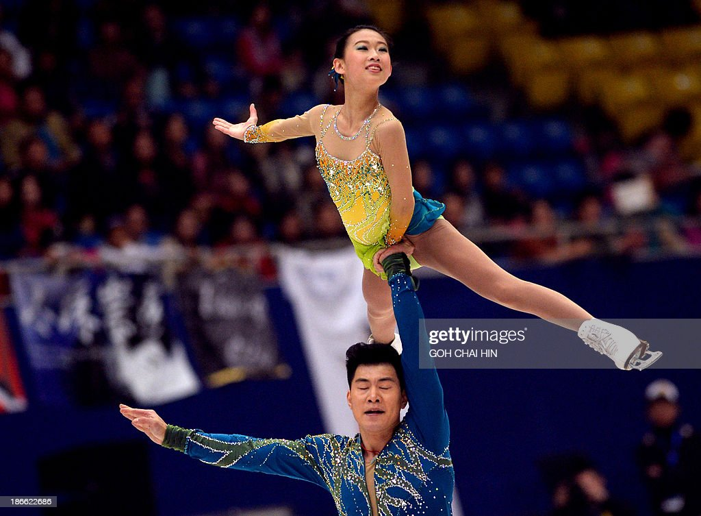 Peng Cheng (top) and Zhang Hao of China perform during the Pairs Free Skating program at the Cup of China ISU Grand Prix of Figure Skating in Beijing on November 2, 2013. Peng and Zhang are in third place with the total score of 187.19 points. AFP PHOTO/GOH CHAI HIN