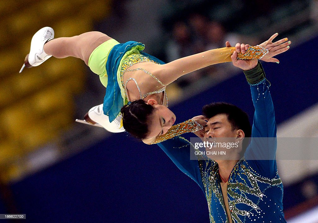 Peng Cheng (L) and Zhang Hao of China perform during the Pairs Free Skating program at the Cup of China ISU Grand Prix of Figure Skating in Beijing on November 2, 2013. Peng and Zhang are in third place with the total score of 187.19 points.