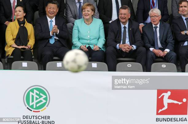 Peng Liyuan Chinese President Xi Jinping German Chancellor Angela Merkel President of the German Football Association Reinhard Grindel and President...