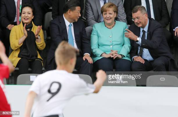 Peng Liyuan Chinese President Xi Jinping German Chancellor Angela Merkel and the President of the German Football Association Reinhard Grindel attend...