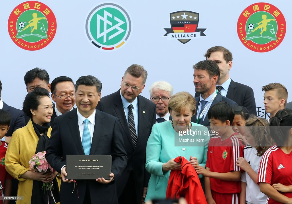 Peng Liyuan, Chinese President Xi Jinping, President of the German Football Association (DFB) Reinhard Grindel, President of the German Football League (DFL) Reinhard Rauball and German Chancellor Angela Merkel (CDU) (L-R) attend the Chinese German football summer camp at Stadion am Wurfplatz on July 5, 2017 in Berlin, Germany.