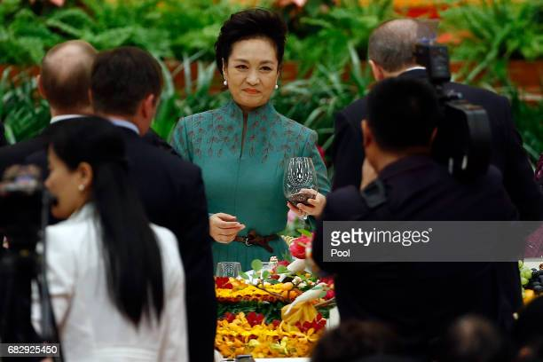 Peng Liyuan wife of Chinese President Xi Jinping attends the welcoming banquet for the Belt and Road Forum at the Great Hall of the People in Beijing...