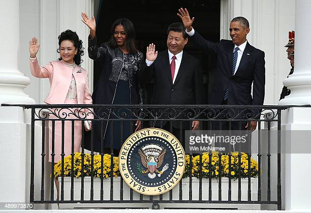 Peng Liyuan wife of Chinese President Xi Jinping US first lady Michelle Obama Chinese President Xi Jinping and US President Barack Obama wave to...