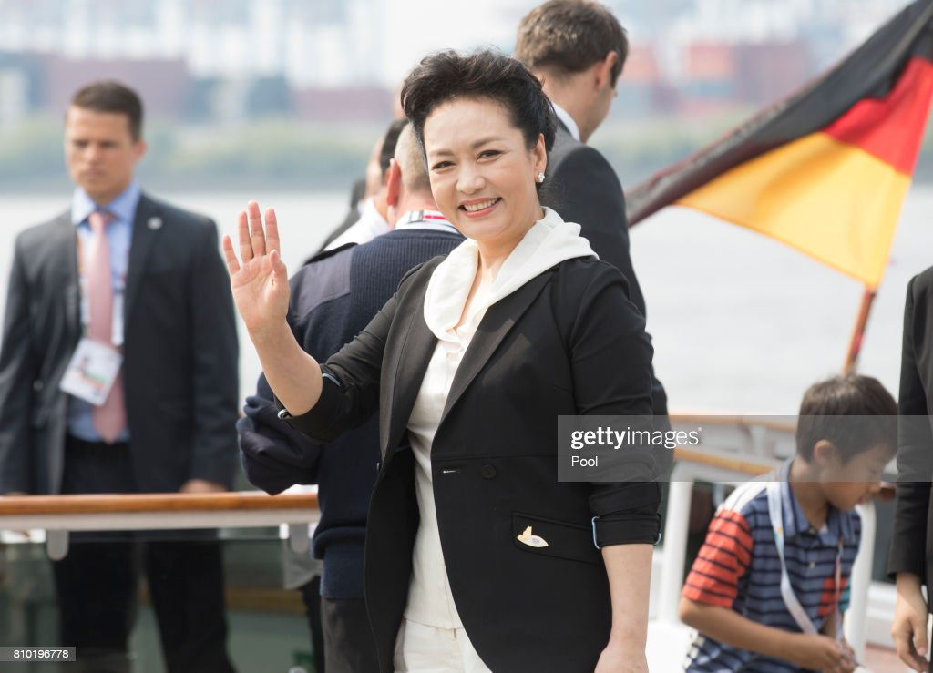 Peng Liyuan, wife of Xi Jinping, President of the People's Republic of China, leaves the boat 'Diplomat' on the river Elbe as she takes part in the G20 Summit Spouse Programme on July 7, 2017 in Hamburg, Germany. Leaders of the G20 group of nations are meeting for the July 7-8 summit. Topics high on the agenda for the summit include climate policy and development programs for African economies.