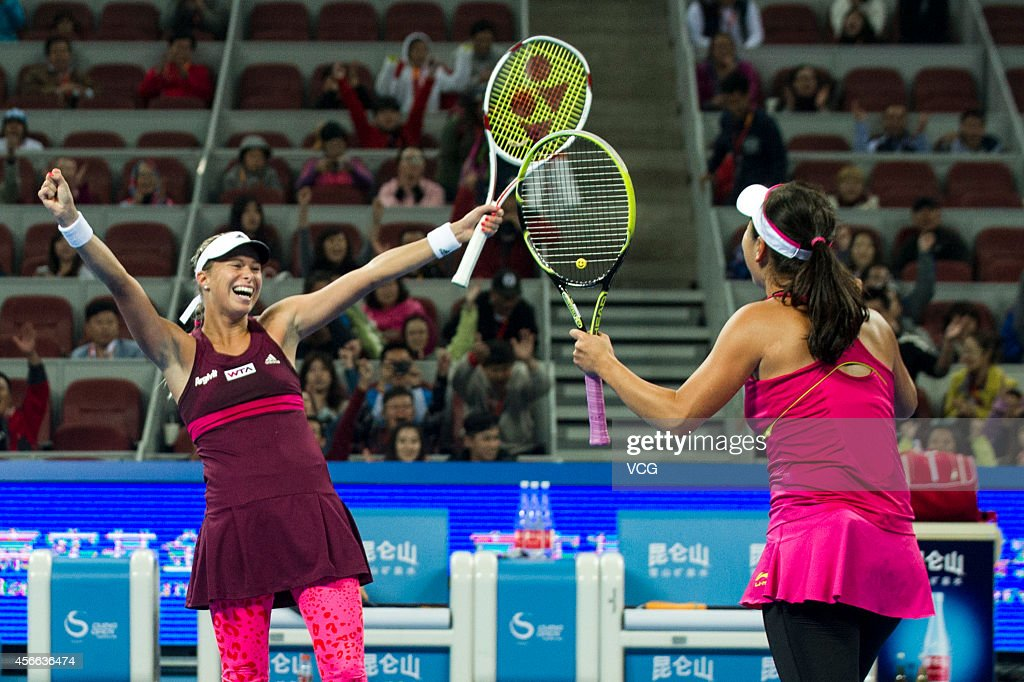 Peng Shuai (R) of China and <a gi-track='captionPersonalityLinkClicked' href=/galleries/search?phrase=Andrea+Hlavackova&family=editorial&specificpeople=3378910 ng-click='$event.stopPropagation()'>Andrea Hlavackova</a> of the Czech Republic react during their final match against Sania Mirza of India and Cara Black of Zimbabwe during day eight of the China Open at the China National Tennis Center on October 4, 2014 in Beijing, China.