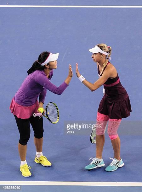 Peng Shuai of China highfives Andrea Hlavackova of the Czech Republic their match against Alla Kudryavtseva of Russia and Anastasia Rodionova of...