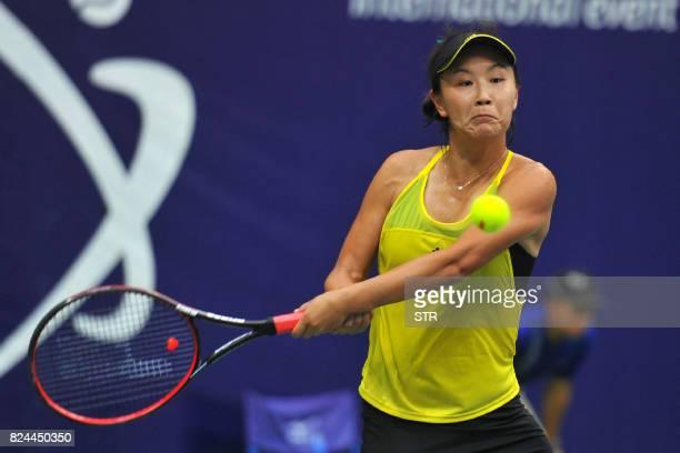 Peng Shuai of China hits a return to Japan's Nao Hibino in the women's singles final at the Jiangxi Open WTA tennis tournament in Nanchang in central...