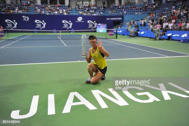 Peng Shuai of China poses with the trophy after defeating Japan's Nao Hibino in the women's singles final at the Jiangxi Open WTA tennis tournament...