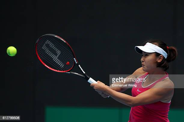Peng Shuai of China returns a shot against Caroline Garcia of France during the Women's singles second round match on day five of the 2016 China Open...