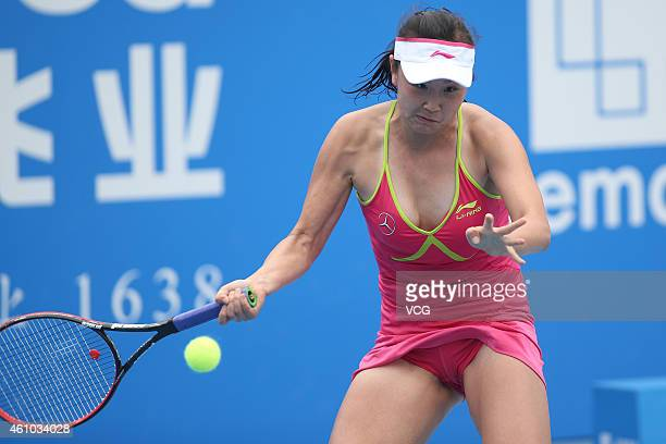 Peng Shuai of China returns a shot against Vera Zvonareva of Russia during day two of the WTA Shenzhen Open at Shenzhen Longgang Sports Center on...