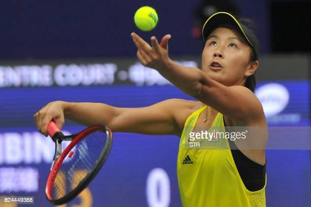 Peng Shuai of China serves to Japan's Nao Hibino in the women's singles final at the Jiangxi Open WTA tennis tournament in Nanchang in central...