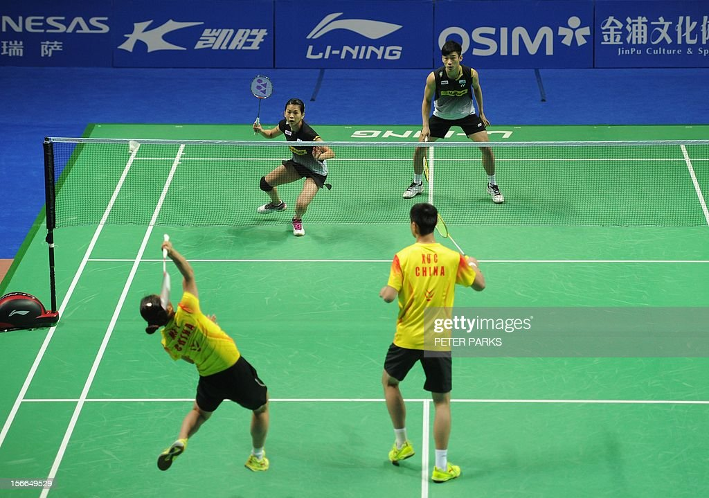 Peng Soon Chan (top R) and Liu Ying Goh (top L) of Malaysia play Xu Chen (bottom R) and Ma Jin (bottom L) of China in the mixed doubles final at the China Open badminton tournament in Shanghai on November 18, 2012. AFP PHOTO/Peter PARKS