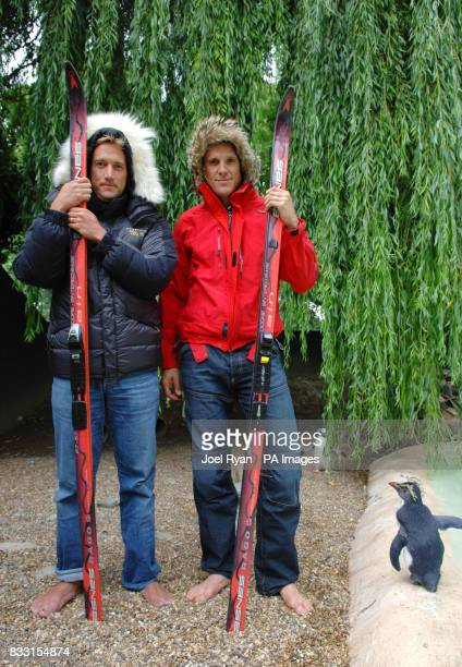 A penguin studies Ben Fogle James Cracknell as they attend a photocall to announce their forthcoming expedition to the South Pole in London Zoo's...