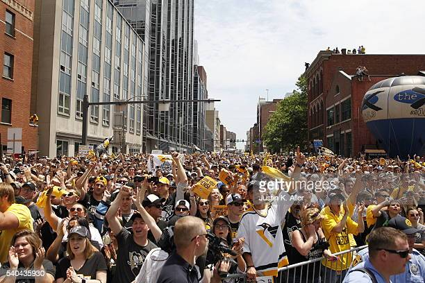 Penguins fans celebrate during the Victory Parade and Rally on June 15 2016 in Pittsburgh Pennsylvania The Penguins defeated the San Jose Sharks to...