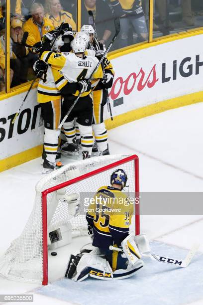 Penguins teammates celebrate goal by Pittsburgh Penguins right wing Patric Hornqvist as Nashville Predators goalie Pekka Rinne looks on during game 6...