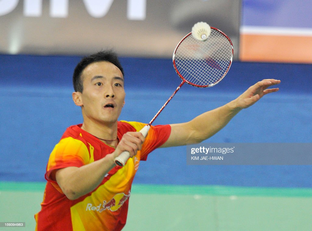 Pengyu Du of China plays a shot during his men's singles badminton match against Lee Chong Wei of Malaysia during the finals of the Korea Open in Seoul on January 13, 2013.