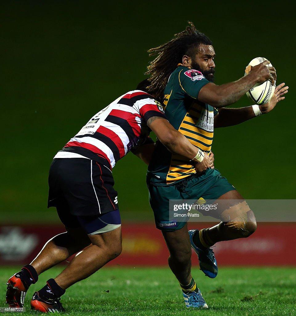 Peni Manumanuniliwa of Mid Canterbury looks to beat a tackle during the Ranfurly Shield match between Counties Manukau and Mid Canterbury at Pukekohe...