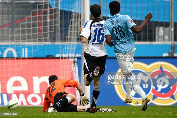 Peniel Kokou Mlapa of Munich scores his team's first goal against Andre Mijatovic and goalkeeper Dennis Eilhoff of Bielefeld during the Second...