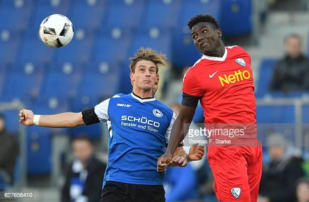 Peniel Mlapa of Bochum and Tom Schuetz of Bielefeld head for the ball during the Second Bundesliga match between DSC Arminia Bielefeld and VfL Bochum...
