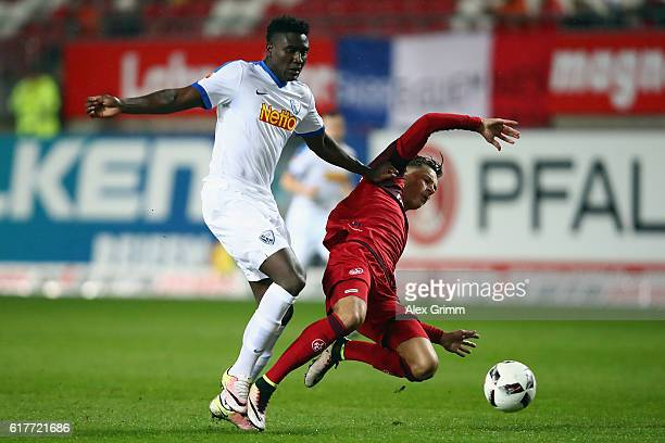 Peniel Mlapa of Bochum is challenged by Robin Koch of Kaiserslautern during the Second Bundesliga match between 1 FC Kaiserslautern and VfL Bochum...
