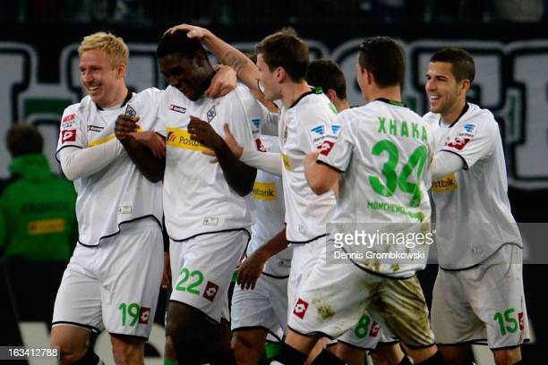 Peniel Mlapa of Moenchengladbach celebrates with teammates after scoring a goal during the Bundesliga match between VfL Borussia Moenchengladbach and...