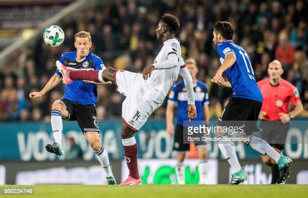 Peniel Mlapa of SG Dynamo Dresden in action with Andreas Voglsammer of Arminia Bielefeld during the Second Bundesliga match between SG Dynamo Dresden...