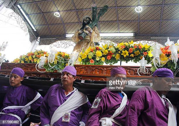 Penintents carry Christ's images during The Procession of the Christs on March 24 2016 in Izalco El Salvador This procession is considered the...