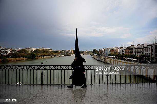 A Penitent goes to his church during Holy Week in Seville on April 2 2012Christians around the world mark the Holy Week of Easter in celebration of...
