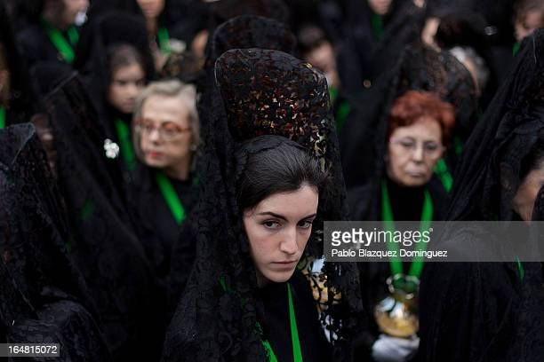 A penitent looks on outside the Cathedral during the Holy Week procession of the Cofradia de la Virgen de la Esperanza on March 28 2013 in Zamora...