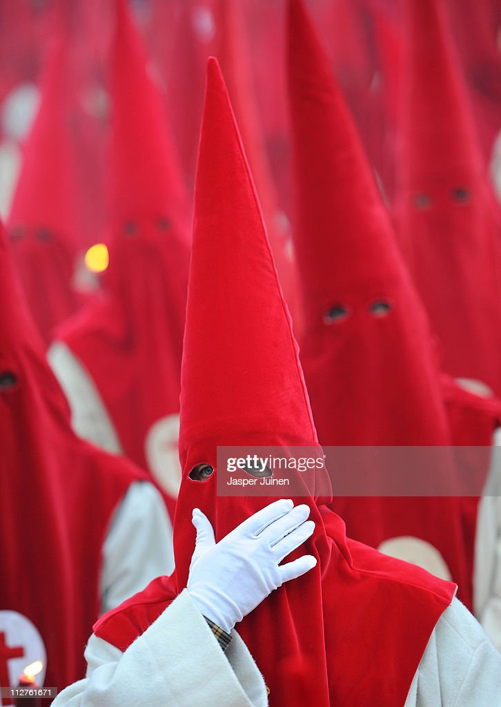 A penitent of the Cofradia del Silencio adjusts his capirote during a Holy Week procession on April 20, 2011 in Zamora, Spain. Easter week is traditionally celebrated with processions in most Spanish towns.
