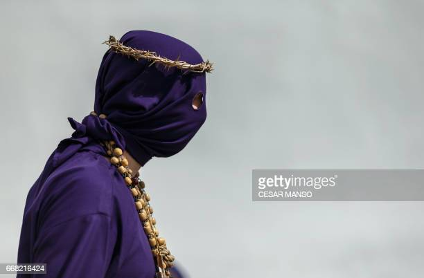 A penitent of the 'Jesus Nazareno' brotherhood take part in the Ecce Homo Passion procession during Holy Week in the northwestern Spanish village of...