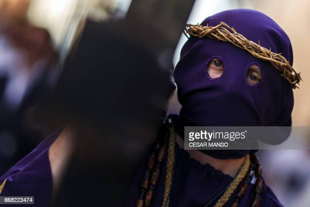 A penitent of the 'Jesus Nazareno' brotherhood takes part in the Ecce Homo Passion procession during Holy Week in the northwestern Spanish village of...
