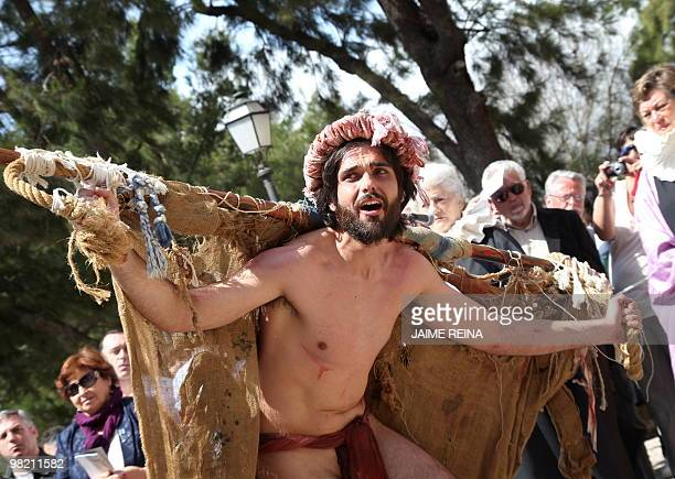 A penitent performs the reenacting of The Via Crucis during the Holy Week in Palma de Mallorca on April 2 2010 Christian believers around the world...