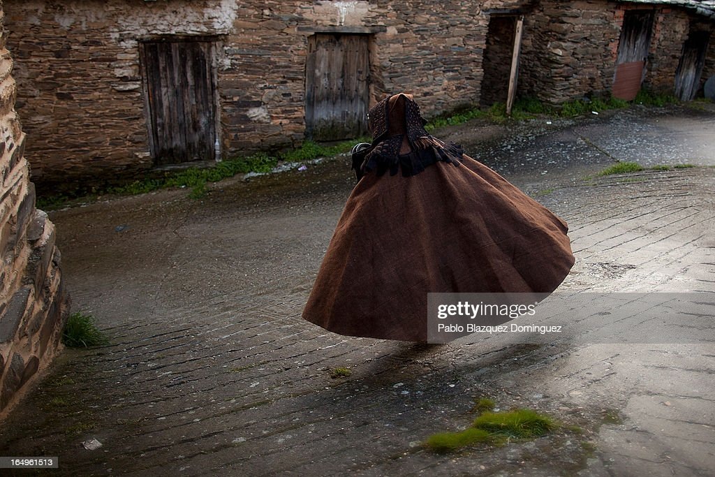 A penitent wearing a brown cape 'capa parda' walks after the Holy Week procession of the Cofradia of Santo Entierro brotherhood on March 29, 2013 in Bercianos de Aliste near Zamora, Spain. The procession was finally stopped because of the rain. Easter week is traditionally celebrated with processions in most Spanish towns.