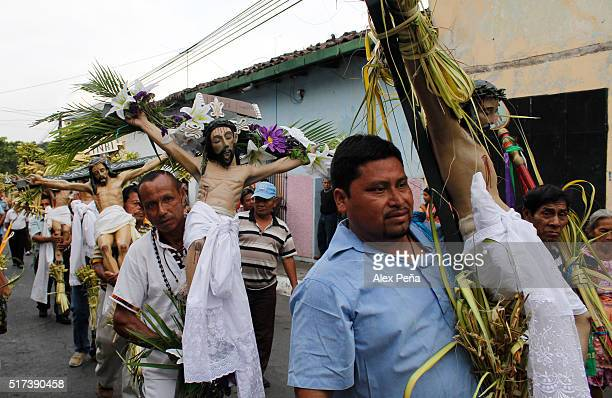 Penitents carry images of Christ during The Procession of the Christs on March 24 2016 in Izalco El Salvador This procession is considered the...