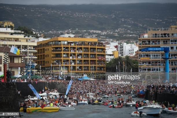 Penitents carry the Virgen del Carmen the patron saint of fishermen to the Puerto de la Cruz on the Spanish Canary island of Tenerife on July 11 2017...