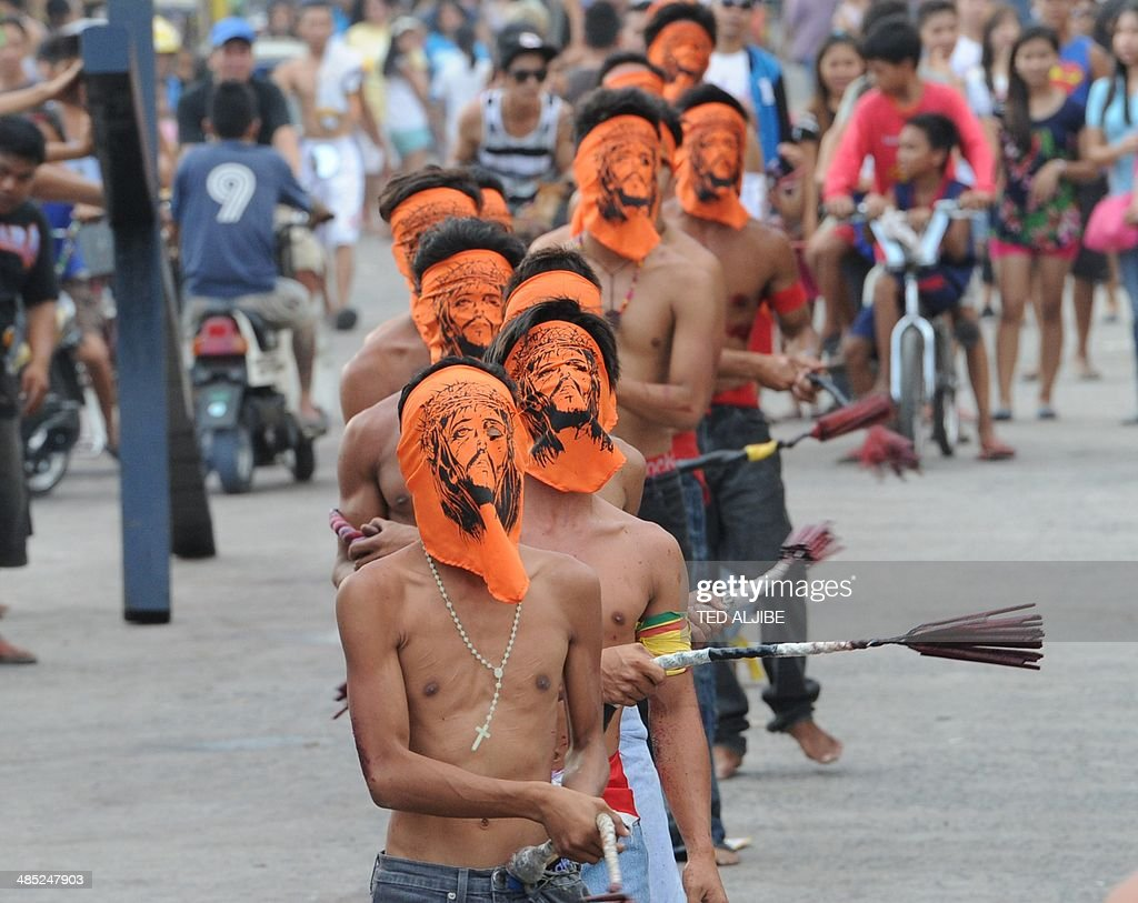 Penitents flagellate themselves as part of Lenten observance in Angeles City, Pampanga province, north of Manila on April 17, 2014. The dominant Roman Catholic church does not condone flagellation and other extreme acts of penitence including gory Good Friday reenactments of the crucifixion of Jesus Christ, but devout Catholics say it is a means of atoning for their sins and to implore God to spare them and other members of their families from illness or bad luck. AFP PHOTO/TED ALJIBE