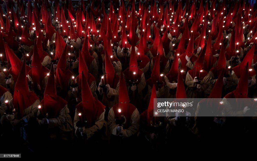 TOPSHOT Penitents from the 'Real Hermandad del Santisimo Cristo de las Injurias El Silencio' brotherhood parade during a Holy Week procession in the...