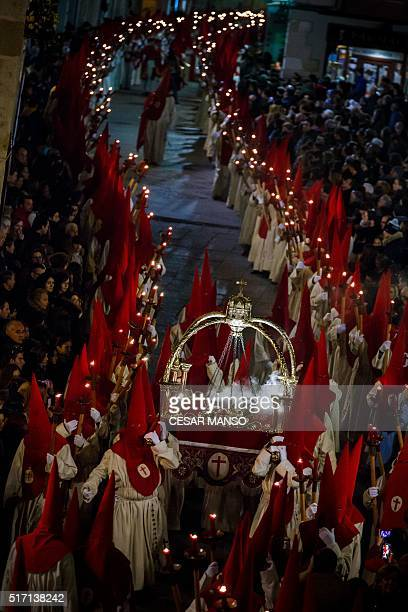 Penitents from the 'Real Hermandad del Santisimo Cristo de las Injurias El Silencio' brotherhood parade during a Holy Week procession in the...