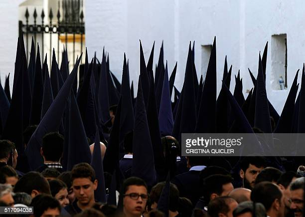 Penitents members of the 'El Baratillo' brotherhood wait to parade during the Easter procession in Sevilla on March 23 2016 Christian believers...