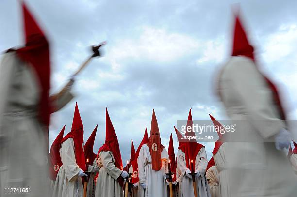 Penitents of the Cofradia del Silencio hold their candles during a Holy Week procession on April 20 2011 in Zamora Spain Easter week is traditionally...