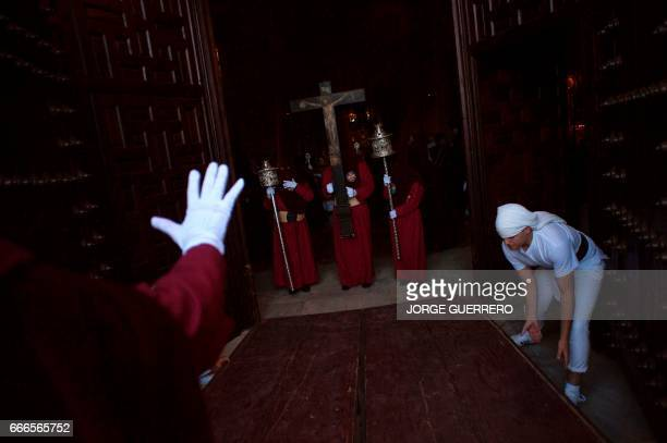 Penitents of the 'Gitanos' brotherhood take part in a procession on April 9 2017 in Ronda during the Holy Week Christian believers around the world...