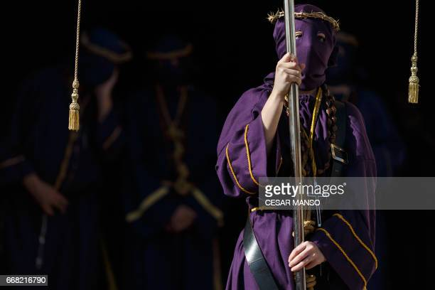 Penitents of the 'Jesus Nazareno' brotherhood take part in the Ecce Homo Passion procession during Holy Week in the northwestern Spanish village of...