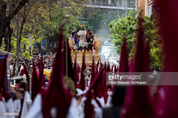 Penitents of the Sagrada Cena brotherhood carry their figure during the Holy Week procession on April 05 2012 in Cordoba Spain Many towns in Spain...