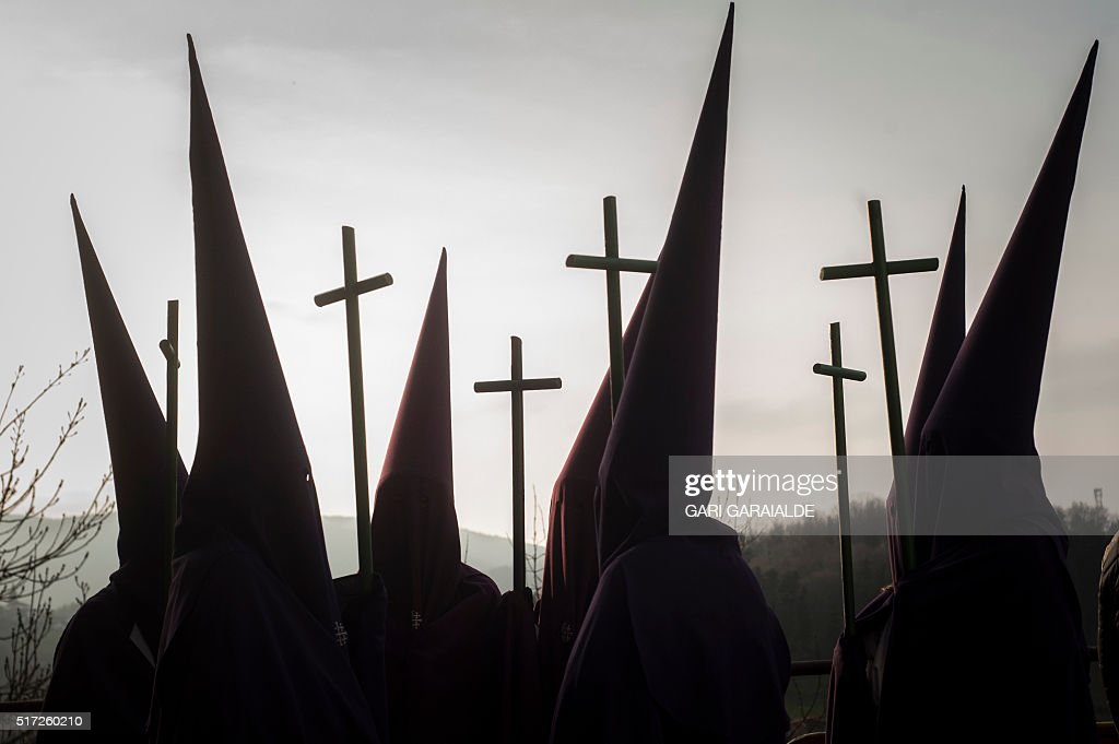 TOPSHOT Penitents parade with crosses during a Holy Week procession in the northern Spanish Basque village of Segura on March 24 2016 Christian...