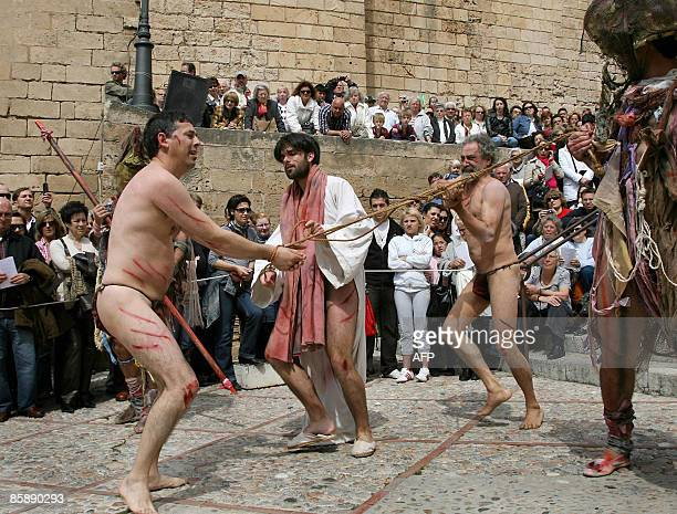 Penitents perform the reenacting of The Via Crucis during the Holy Week in Palma de Mallorca on April 10 2009 Christian believers around the world...