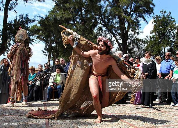 Penitents perform the reenacting of The Via Crucis during the Holy Week in Palma de Mallorca on April 2 2010 Christian believers around the world...