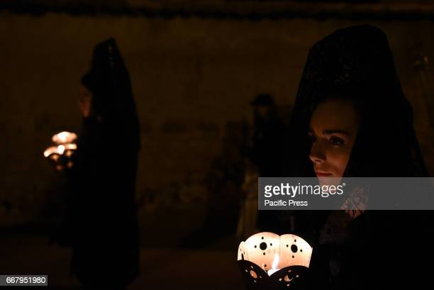 Penitents pictured during the procession of Holy Wednesday in Almazán north of Spain