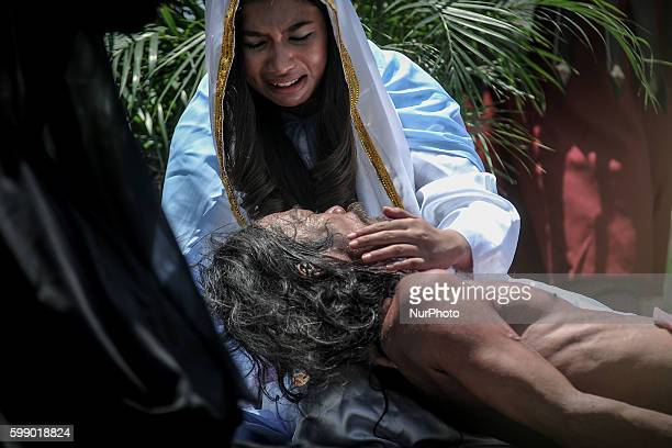 Penitents take part in a reenactment of Jesus Christ's crucifixion during Good Friday in San Fernando town Pampanga province Philippines April 18...
