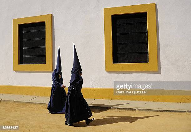 Penitents walk to church for the start of the' El Baratillo' brotherhood procession during the Holy Week in Sevilla on April 8 2009 Christian...